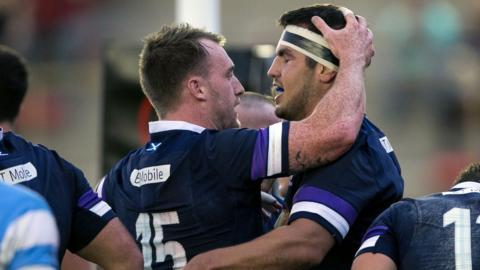 Stuart Hogg helps Stuart McInally celebrate his try against Argentina