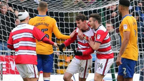 Doncaster Rovers' Liam Mandeville celebrates his penalty against Mansfield