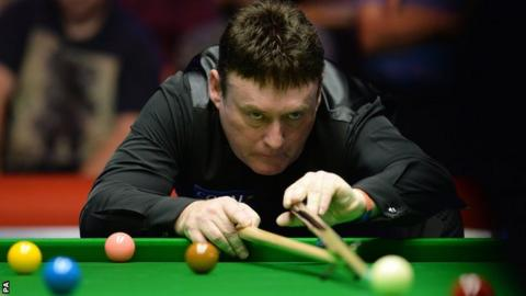 Jimmy White lines up a shot