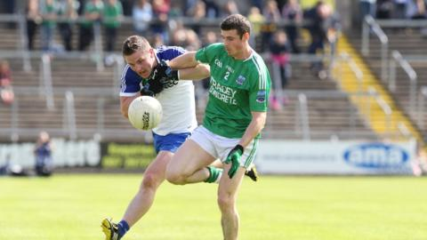 Dermot Malone of Monaghan and Fermanagh's Mickey Jones keep their eyes on the ball as the Farney County book a place in the 19 July final