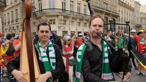 Two Republic of Ireland fans play the harp and the bagpipes at Euro 2016