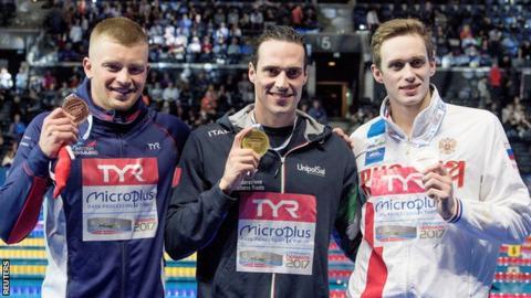 Adam Peaty with his bronze medal in Copenhagen as Fabio Scozzoli celebrates with the gold