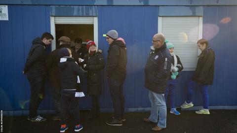 Supporters queue at the refreshment hut