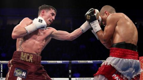 Anthony Crolla (left) lands a punch on Frank Urquiaga (right) during their lightweight bout
