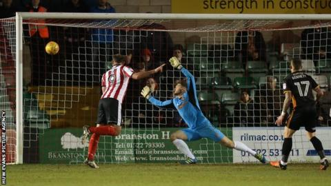 Matt Rhead headed Lincoln into an early lead at Sincil Bank
