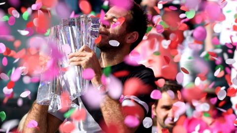 Juan Martin Del Potro of Argentina holds up the trophy after his victory over Roger Federer of Switzerland in the ATP final during the BNP Paribas Open at the Indian Wells Tennis Garden on March 18, 2018 in Indian Wells, California
