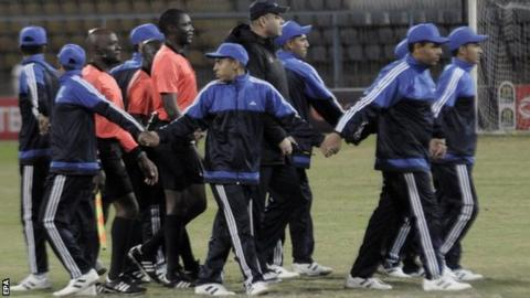 Referee being escorted from the pitch during Ismaily v Club Africain in the Africa Champions League