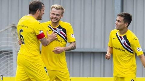 Andy Ryan (centre) celebrates doubling Dunfermline's lead