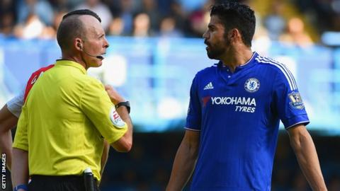 Mike Dean speaks to Diego Costa