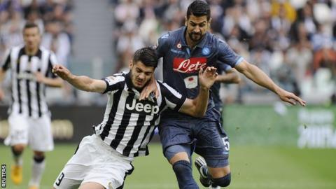 Ex-Napoli Miguel Britos tackles Alvaro Morata of Juventus