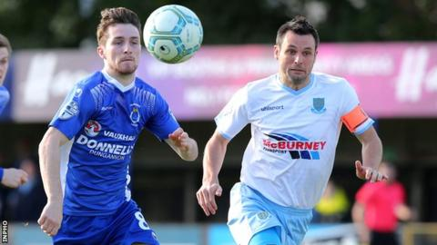 Dungannon's Ryan Mayse and Ballymena United's Jim Ervin