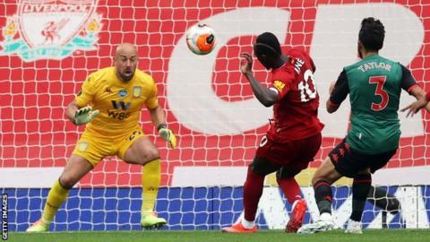 Sadio Mane of Liverpool scores against Aston Villa