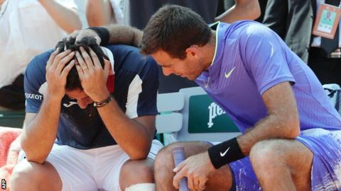 Almagro consoled by Del Potro