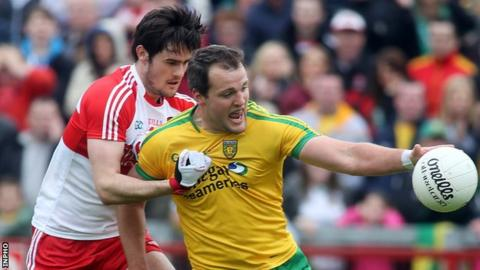 Chrissy McKaigue battles with Donegal's Michael Murphy in the 2014 Ulster SFC tie at Celtic Park