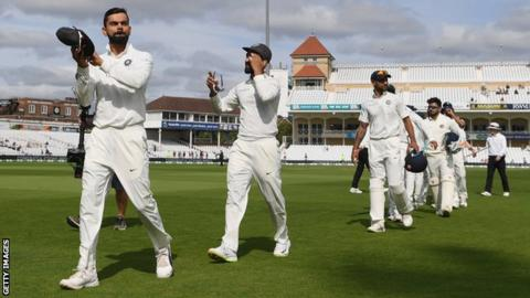 Virat Kohli leads his players from the field after victory at Trent Bridge