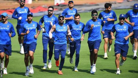 Kohli (centre) leads his team in training before a T20 match against Australia on Sunday