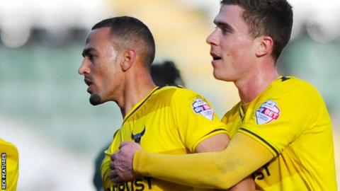 Kemar Roofe celebrates at Plymouth