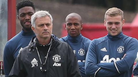 Manchester United 's Jose Mourinho, Luke Young and James Wilson at a training session