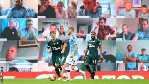 Man united news  football news  football transfer and rumours Fans watch the game between Manchester City and Newcastle on a big video screen