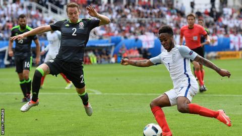 Chris Gunter moves to tackle Raheem Sterling at Euro 2016