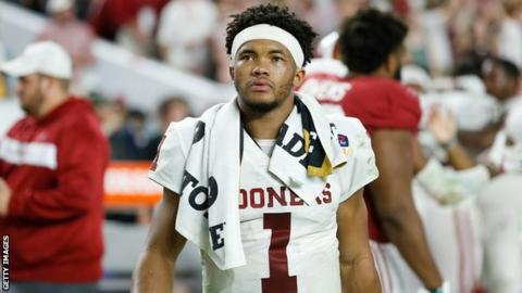 Quarterback Kyler Murray walks off the field after a game for Oklahoma Sooners
