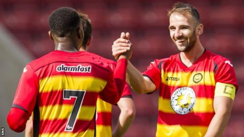 David Amoo and Sean Welsh celebrate with Partick Thistle