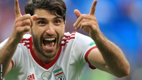 Karim Ansarifard celebrates a World Cup goal for Iran