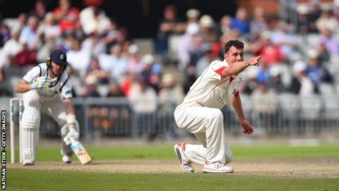 Ryan McLaren's removal of Warwickshire's Ian Bell was the home side's big breakthrough at Old Trafford