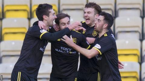 Livingston's Ryan Hardie (left) celebrates his second goal