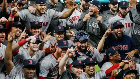Boston Red Sox celebrate after winning the American League pennant