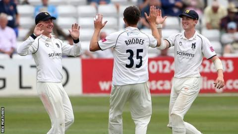 Warwickshire's Will Rhodes finished with match figures of 9-55, including the prize wicket of Sir Alastair Cook twice