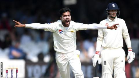 Pakistan fast bowler Mohammad Amir celebrates taking a wicket in a Test against England in 2018