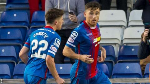 Inverness Caley Thistle's Ryan Christie congratulates scorer Greg Tansey