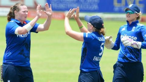 Anya Shrubsole (left) celebrates a wicket