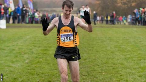 Paul Pollock celebrates as he he crosses the finish line to win the Irish title