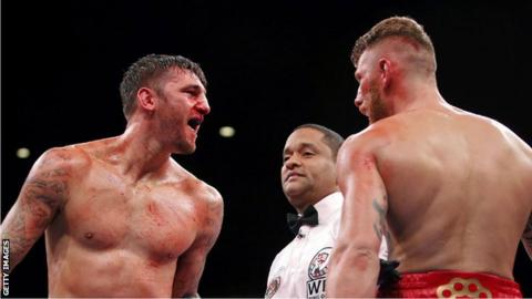 Nathan Cleverly confronts Andrzej Fonfara at the end of a round