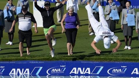 APRIL 02: Pernilla Lindberg of Sweden jumps into the water with her fiance Daniel Taylor and her parents Jan and Gunilla Lindberg after winning the the ANA Inspiration on the Dinah Shore Tournament Course at Mission Hills Country Club on April 2, 2018 in Rancho Mirage, California. (Photo by Robert Laberge/Getty Images)