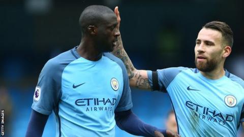 Manchester City midfielder Yaya Toure (right)