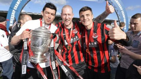 Crusaders players celebrate their Premiership triumph at the end of April