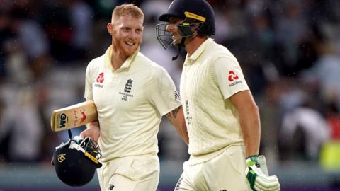 Ben Stokes and Jos Buttler leave the field at the end of day four