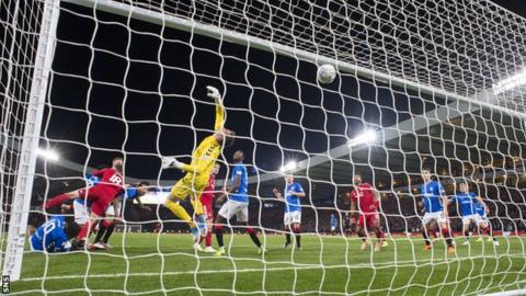 Lewis Ferguson scores for Aberdeen in the League Cup semi-final against Rangers