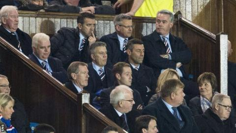 Rangers manager Pedro Caixinha sits in the stand, surrounded by the club's directors