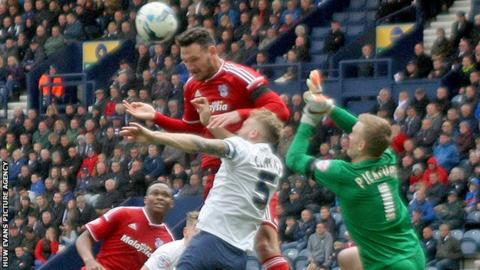 Sean Morrison of Cardiff goes close with a header