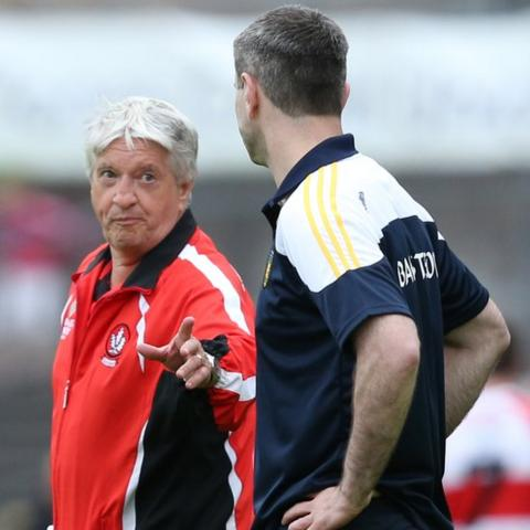 Derry manager Brian McIver appears to be getting a point across to his Donegal counterpart Rory Gallagher