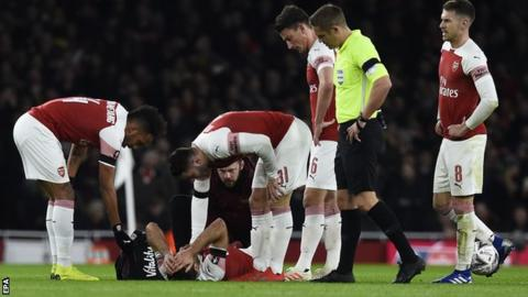 Sokratis Papastathopoulos was injured during Friday's FA Cup defeat by Manchester United