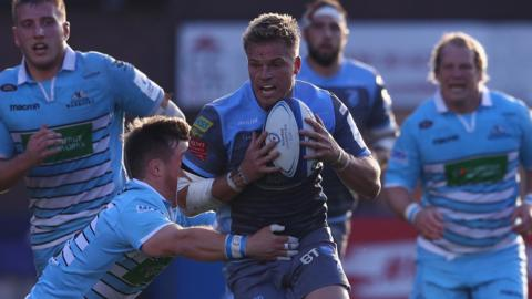 Gareth Anscombe of Cardiff Blues is tackled by George Horne of Glasgow
