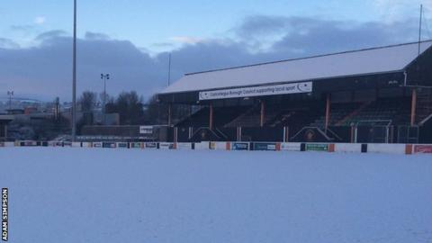 The pitch at Carrick Rangers covered by a blanket of snow