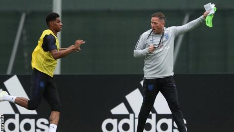 England assistant manager Steve Holland was seen clutching training notes on Thursday