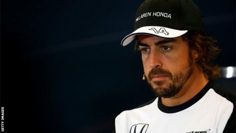 Fernando Alonso looking glum