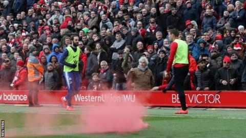The flare was thrown onto the Anfield pitch after it landed among Chelsea fans